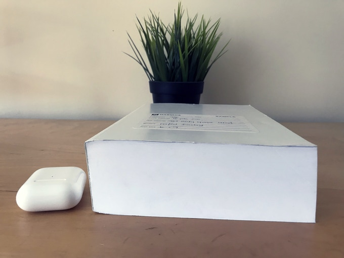 """If you didn't watch the video above, this is a """"blank"""" from the printer, showing the final book's stock, dimensions and page count. This is how big it will be on your shelf! AirPods for scale."""