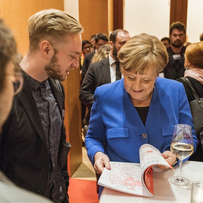 Ellery Studio Co-Founder Eugen Litwinow with Chancellor Angela Merkel