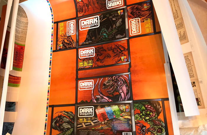 The packaging art. The sides of the package have simple ink drawings on them so that the focus is on the front and back of the box. When the box is opened, full-color art is revealed.