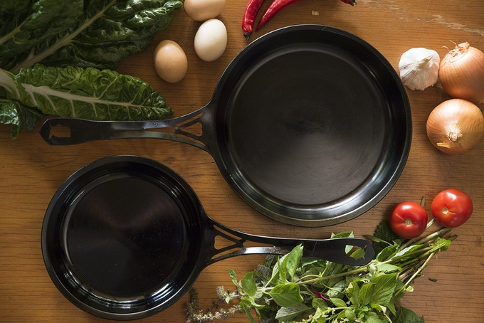 Above are beautifully seasoned US-ION skillets, seasoned according to our instructions, but there are many good ways to season iron pans. We certainly didn't invent seasoning: it has been done for the 2,000+ years iron/steel pans have been made!