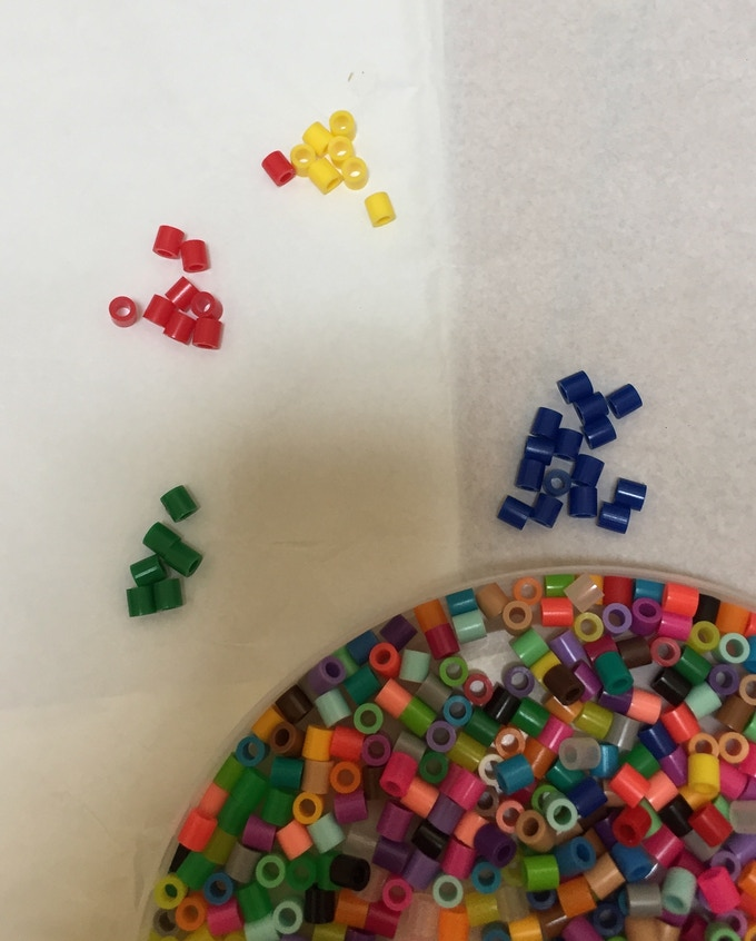 Perler beads are way cheaper when you buy them by the buckets. Then, we have to sort out the colors.