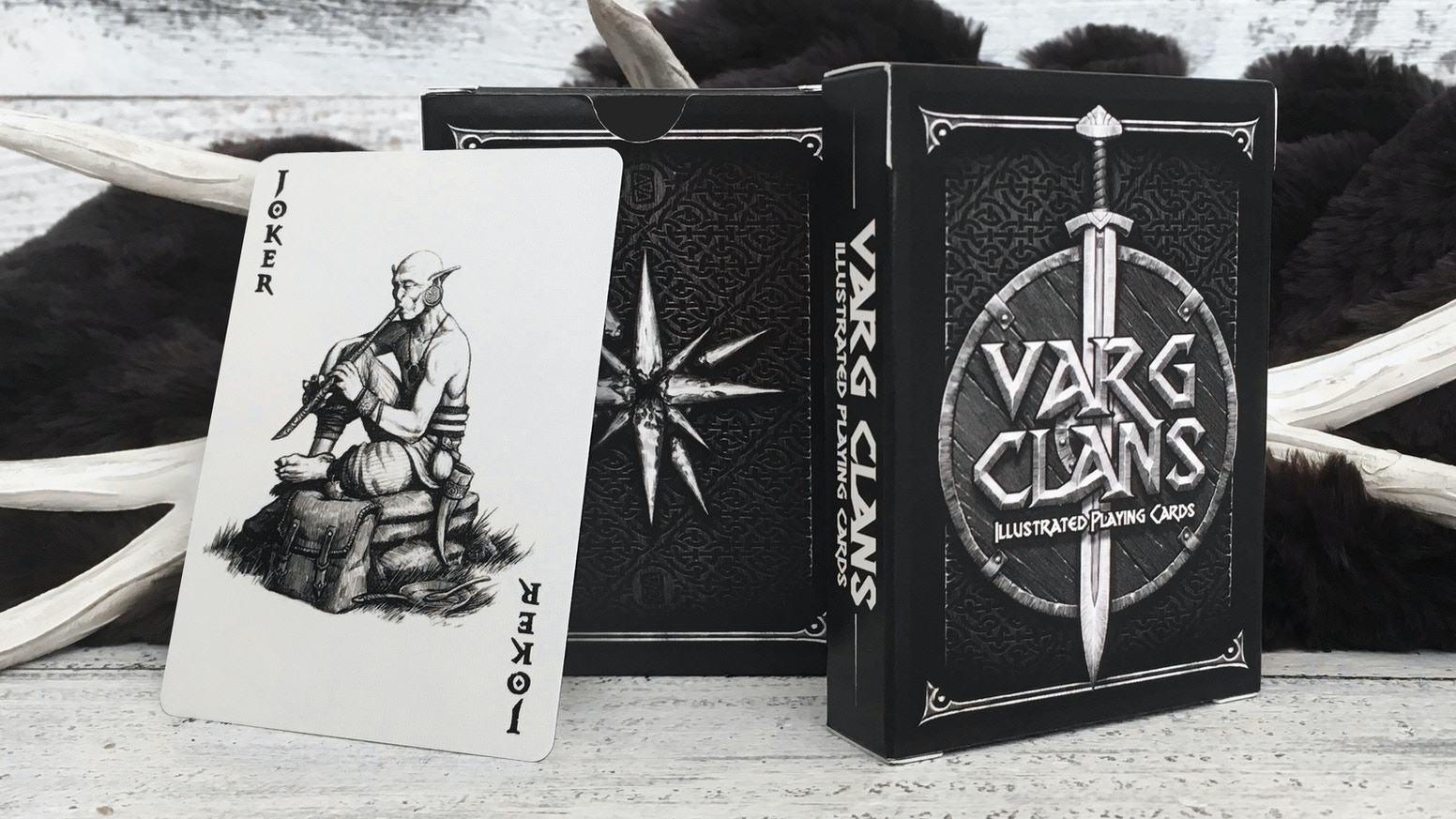 An illustrated playing card deck featuring characters from the Omenshard universe by fantasy artist Blake E. Davis.