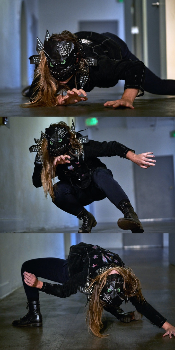 DISSECTED SUIT JACKET AND MASK : Click for detailed shot. Dancer: Tess Hewlett. Photo: Sean Deckert.