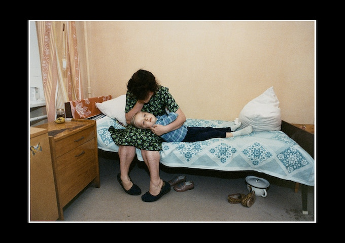 A mother holds her dying son, believed to be a Chernobyl victim