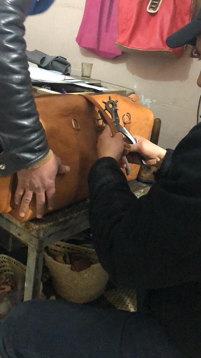 Artisans crafting a Navigator Duffle