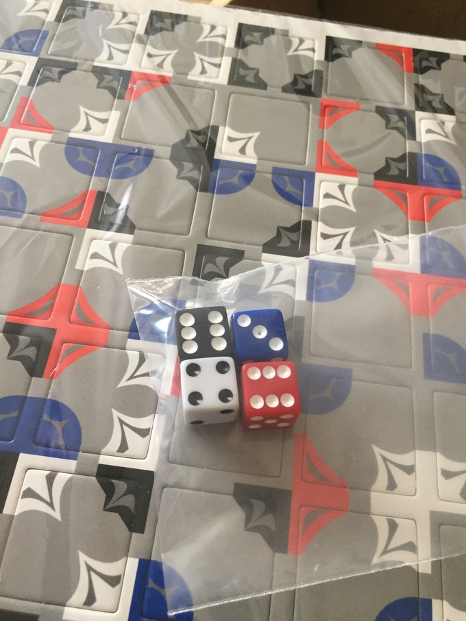 In the end this manufacturer couldn't get accurate cutouts within 1mm so they were rejected, their dice were also not so nice. Still, you get the idea.