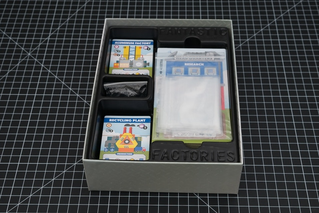 Plastic box tray, plastic zip bags, cards, and player boards