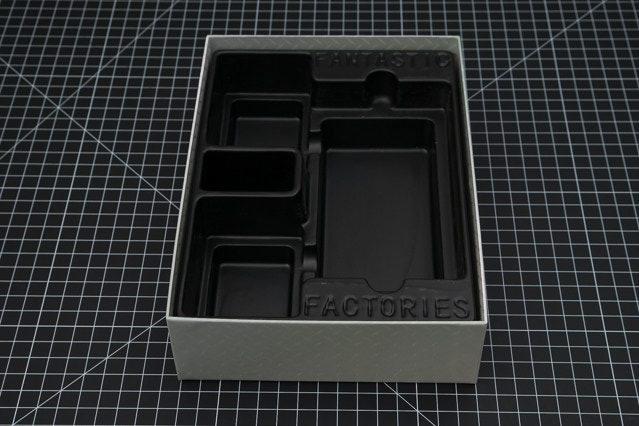 The box insert/tray in the box bottom.