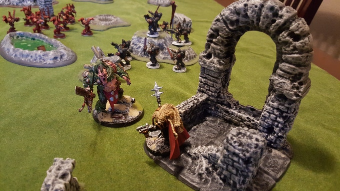 couple of miniatures fighting it out on the arch ruin