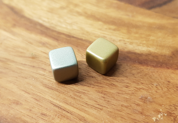 Sample of the plastic cubes we will use as counters. Missing: Black one and red (blood coloured one),