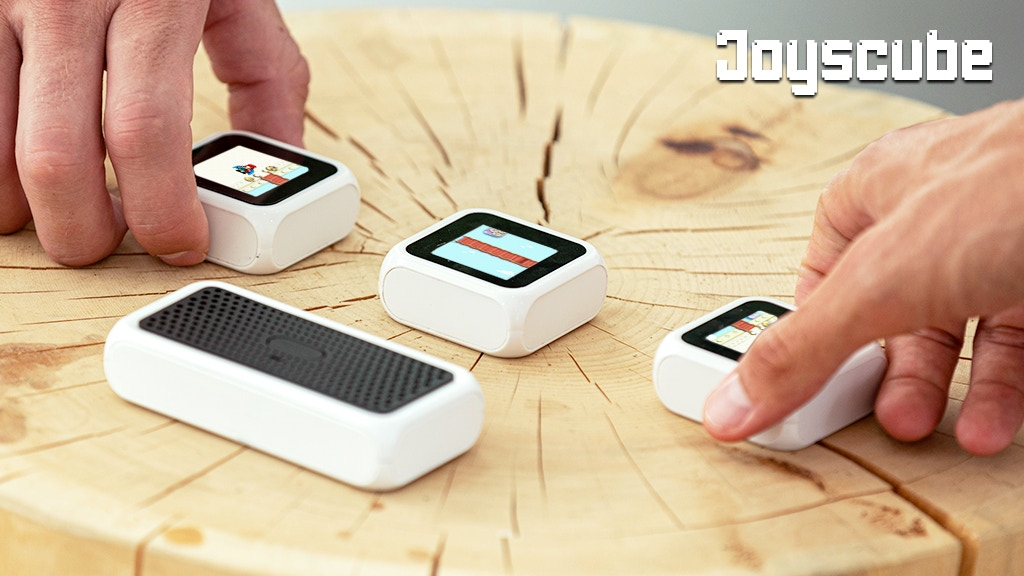 Joyscube Interactive gaming system with hybrid cube consoles