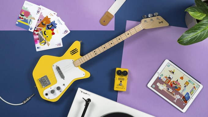 Loog Pro Electric in yellow. Scroll down to REWARDS to see all available colors.