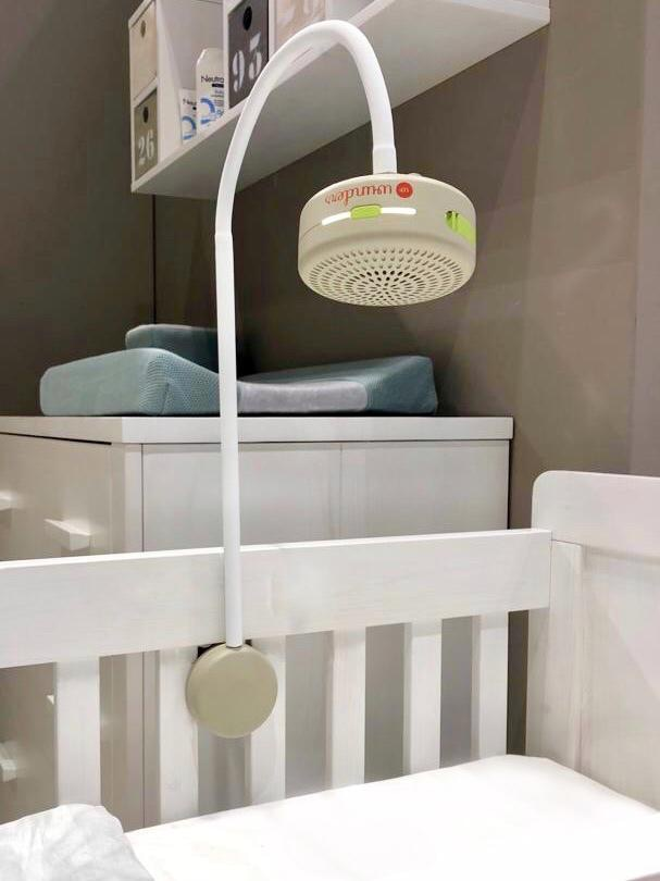 Mobile arm is easily and securely fixed in between the slats of the baby crib