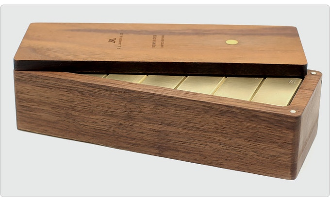 Every set comes with a custom Walnut box with Brass or Copper inlay on the top.