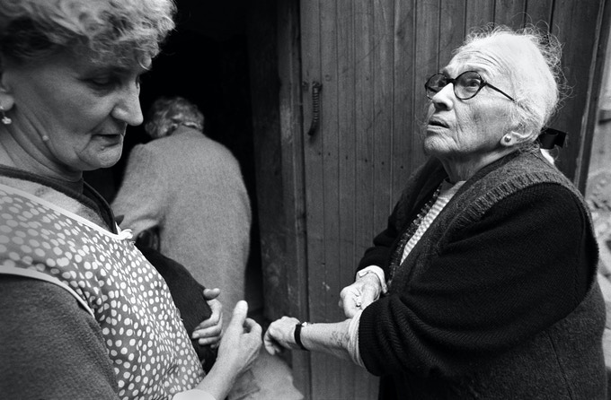 My mother showing proof to a woman who claimed Jews never lived in the building where she was raised in Zawiercie, Poland