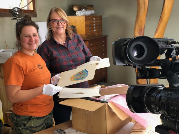 Producer Marianne Gerdes and Ilan-Lael Archivist Laurel Cost prepare James' artworks for the camera