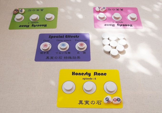 Three players set up. Each player has two Honesty stones.