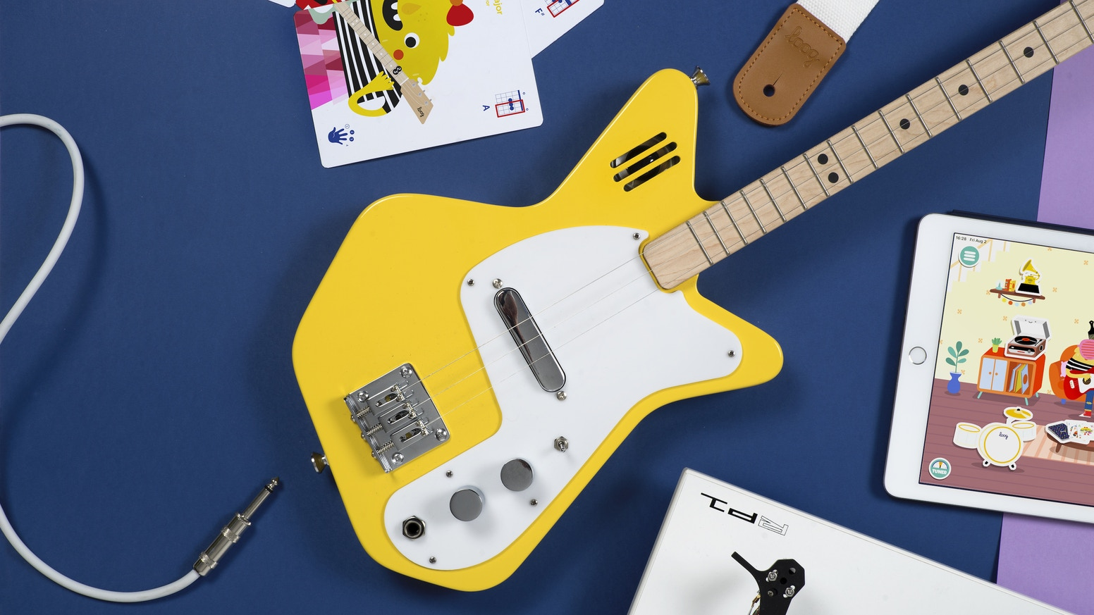 Electric guitars with a built-in amplifier and an app that teaches you to play through Augmented Reality, games and... monsters!