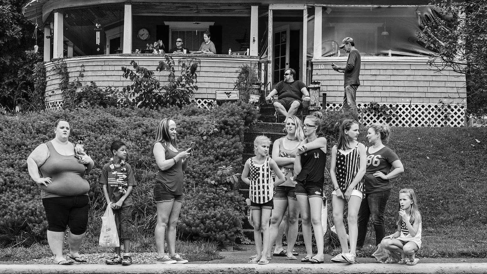 A beautiful lay-flat photo book.   A parade of Americans. One after the other, from one community to the next, building up a picture of Americans across the United States