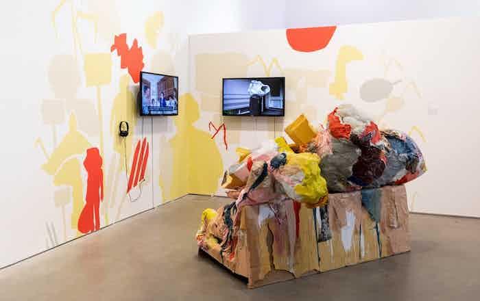 The Future is Bright by Katya Grokhovsky, 2019, sofa, toys, fabrics, found objects, acrylic, wall paint, video, BRIC House, NYC, photo: Walter Wlodarczyk