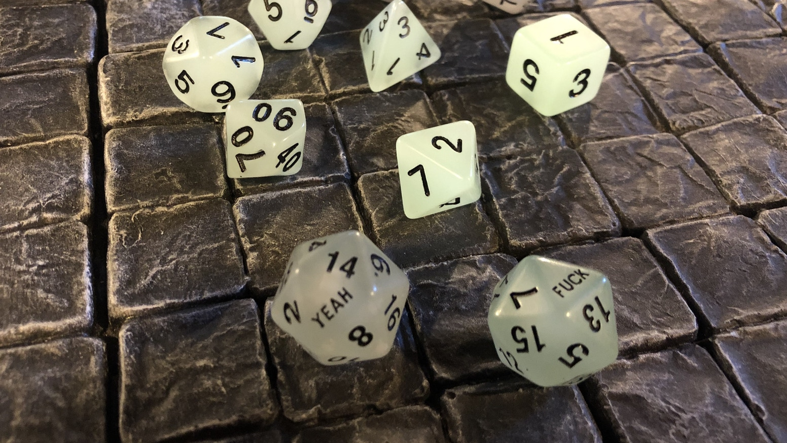 Limited edition glow-in-the-dark dice sets