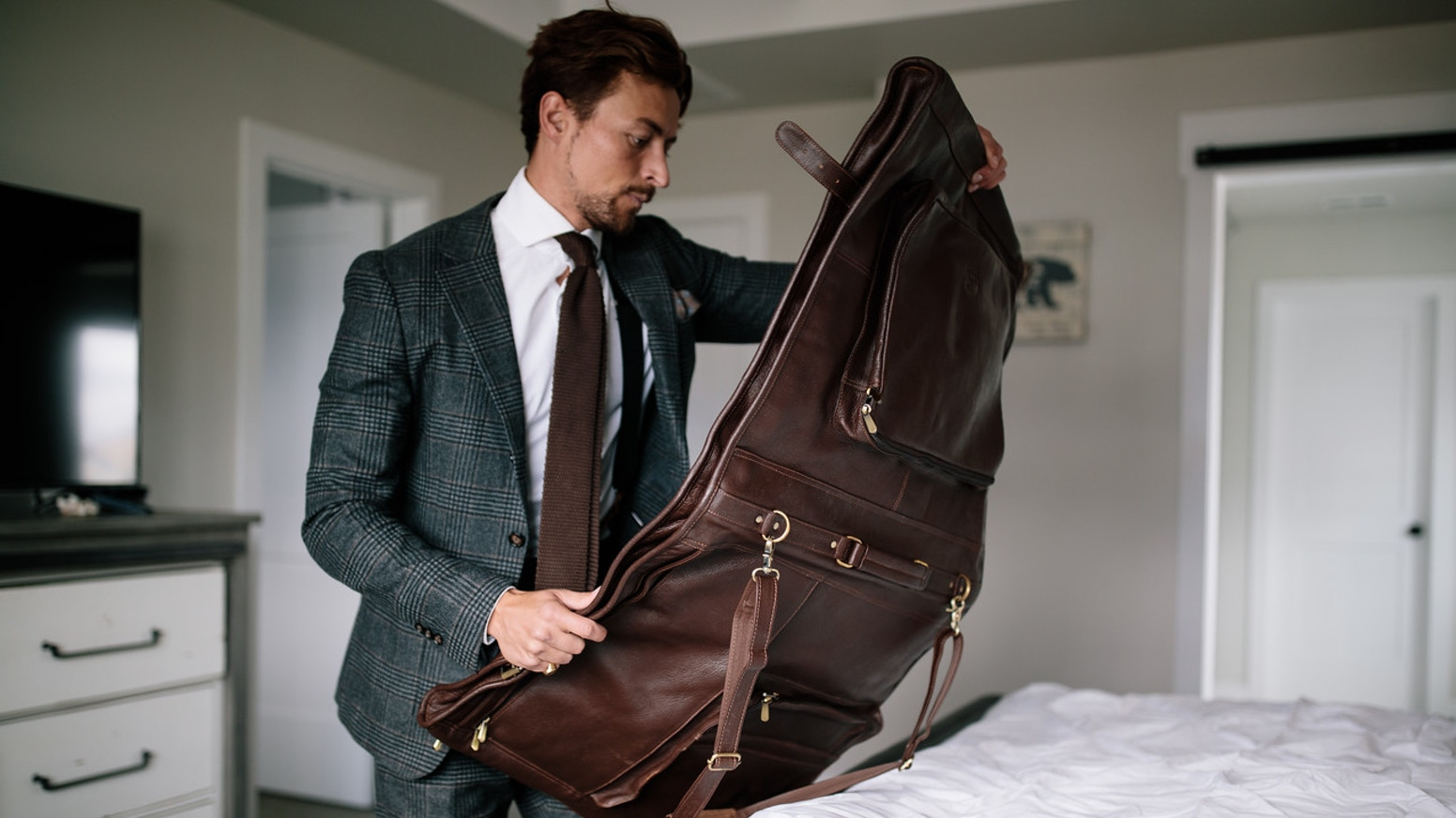 An heirloom quality, full-grain leather garment bag you can pass down for generations.