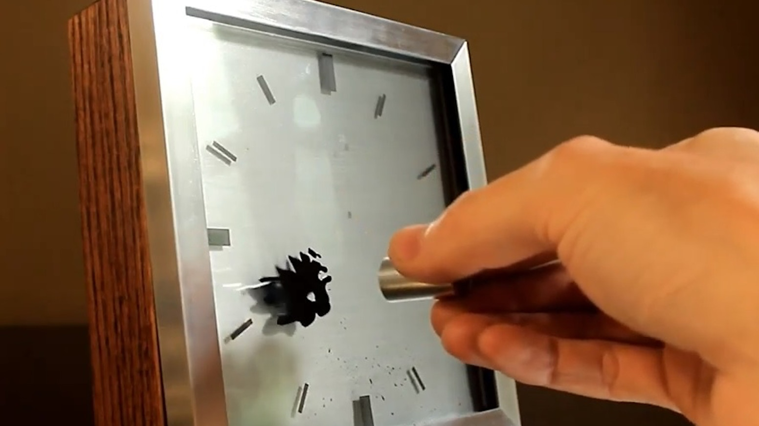 An amazing new clock design featuring magnetic liquid hands, a modular design and changeable faces.