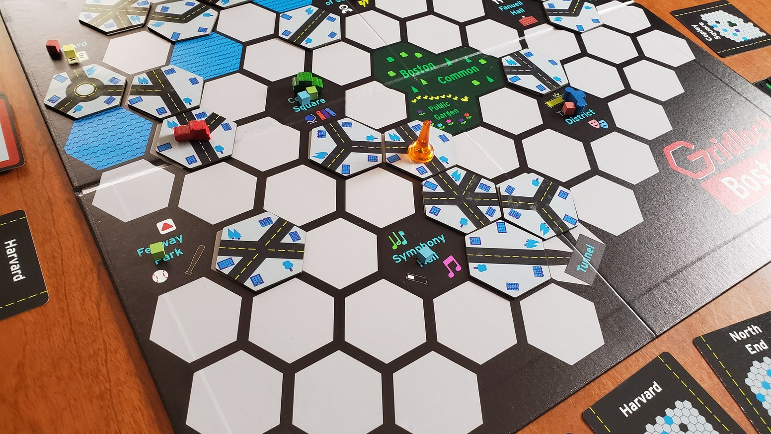 A competitive board game for 2-4 players about driving through the city where the roads make no sense and everything is always changing on you.