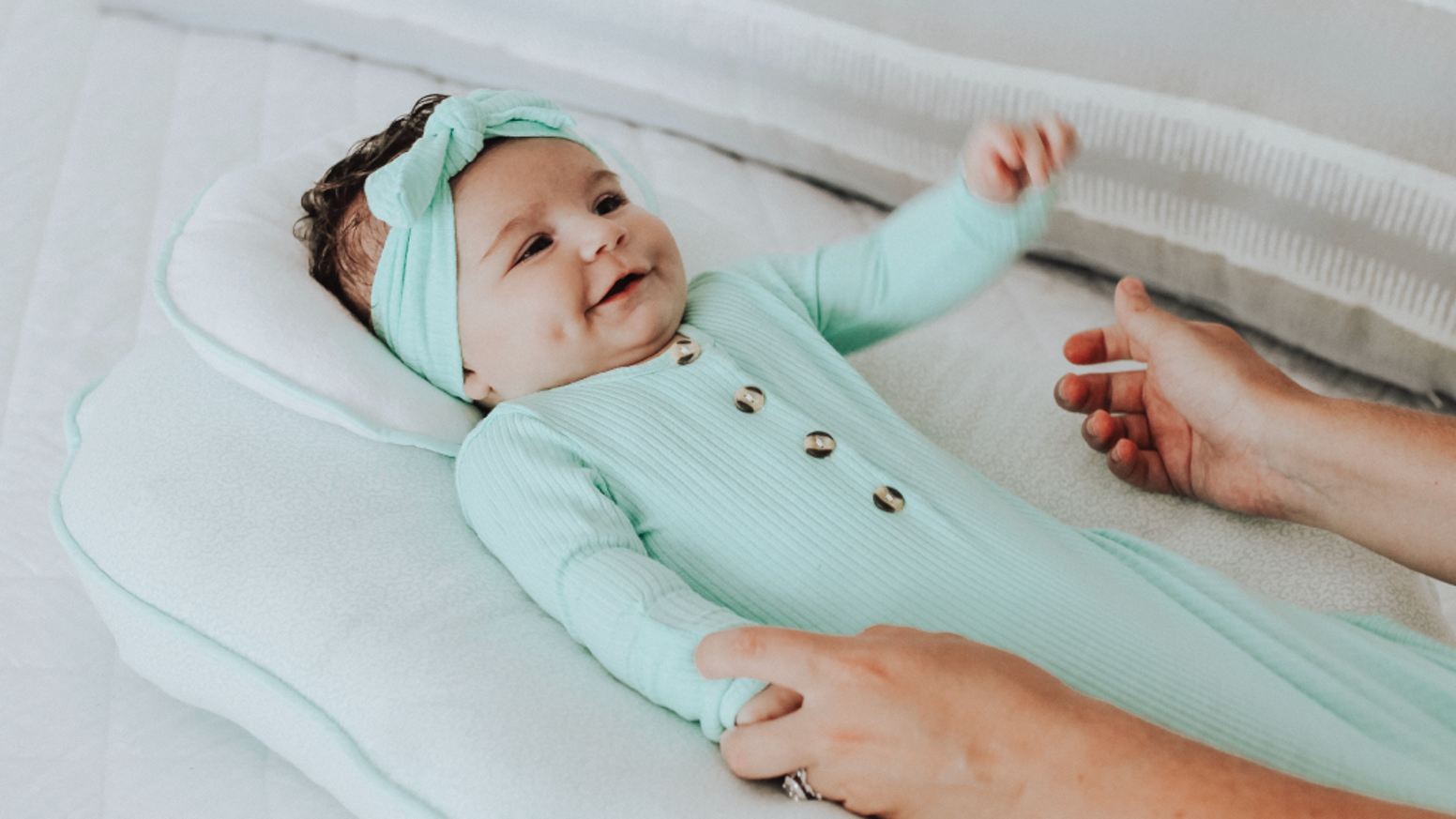 A 3-in-1 baby product, perfect for tummy time, lounging, and breast-feeding.