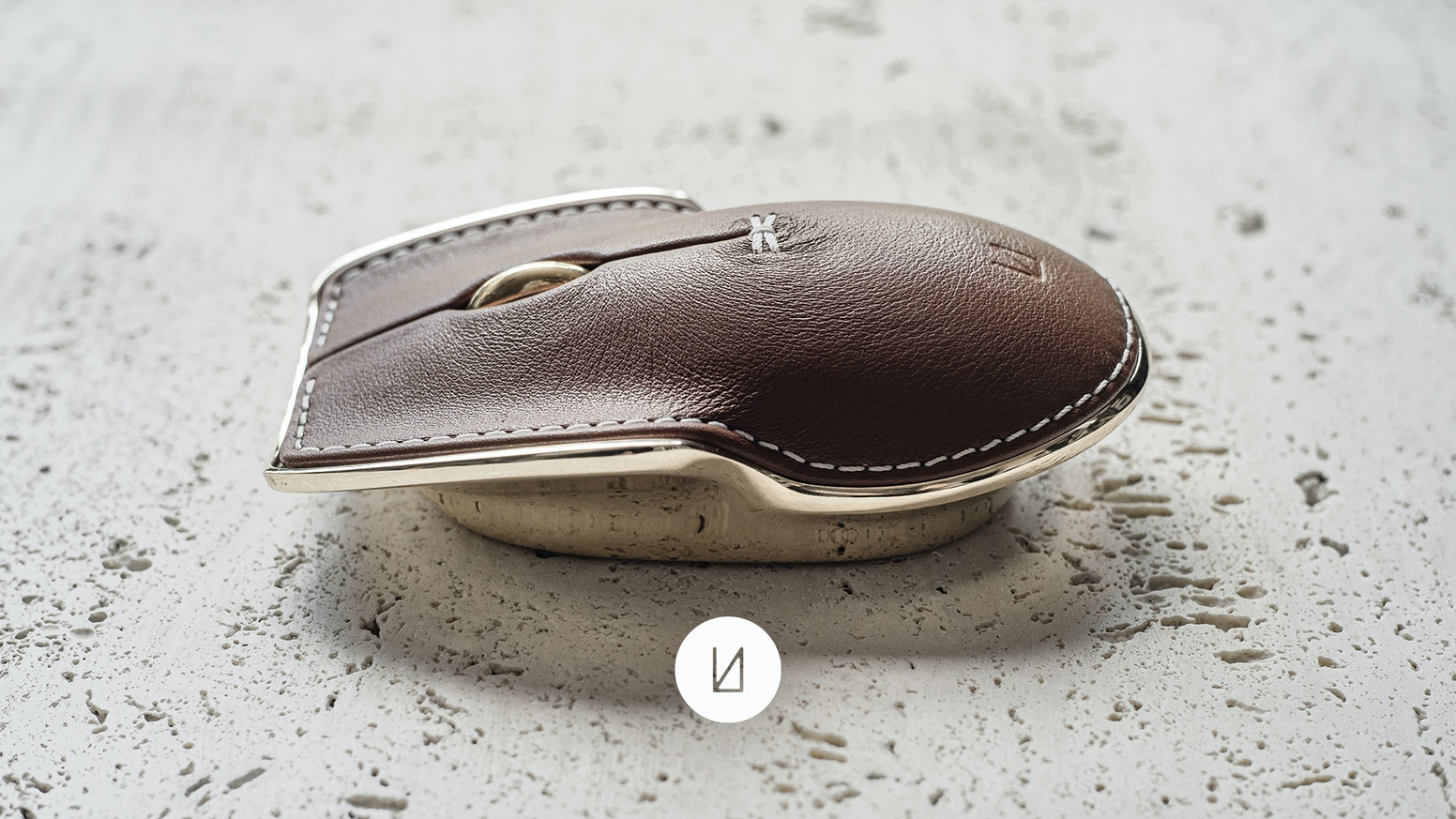 The Pointer Instrument by Lunar Artefacts is a metal and leather mouse tailored for your life's adventure.