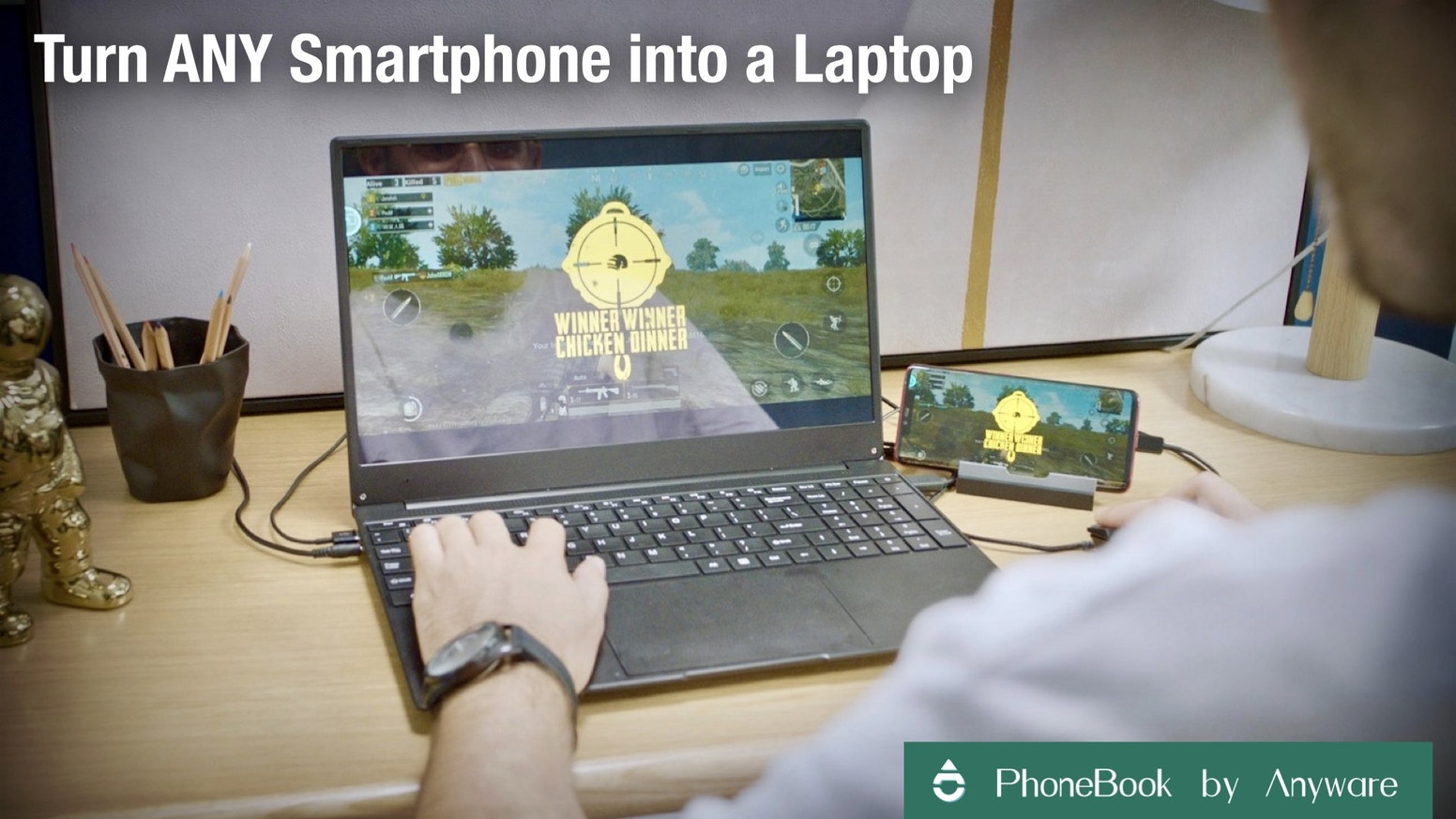 "A plug-in-and-play device that can turn ANY smartphone into a 15.6"" touchscreen laptop in seconds"