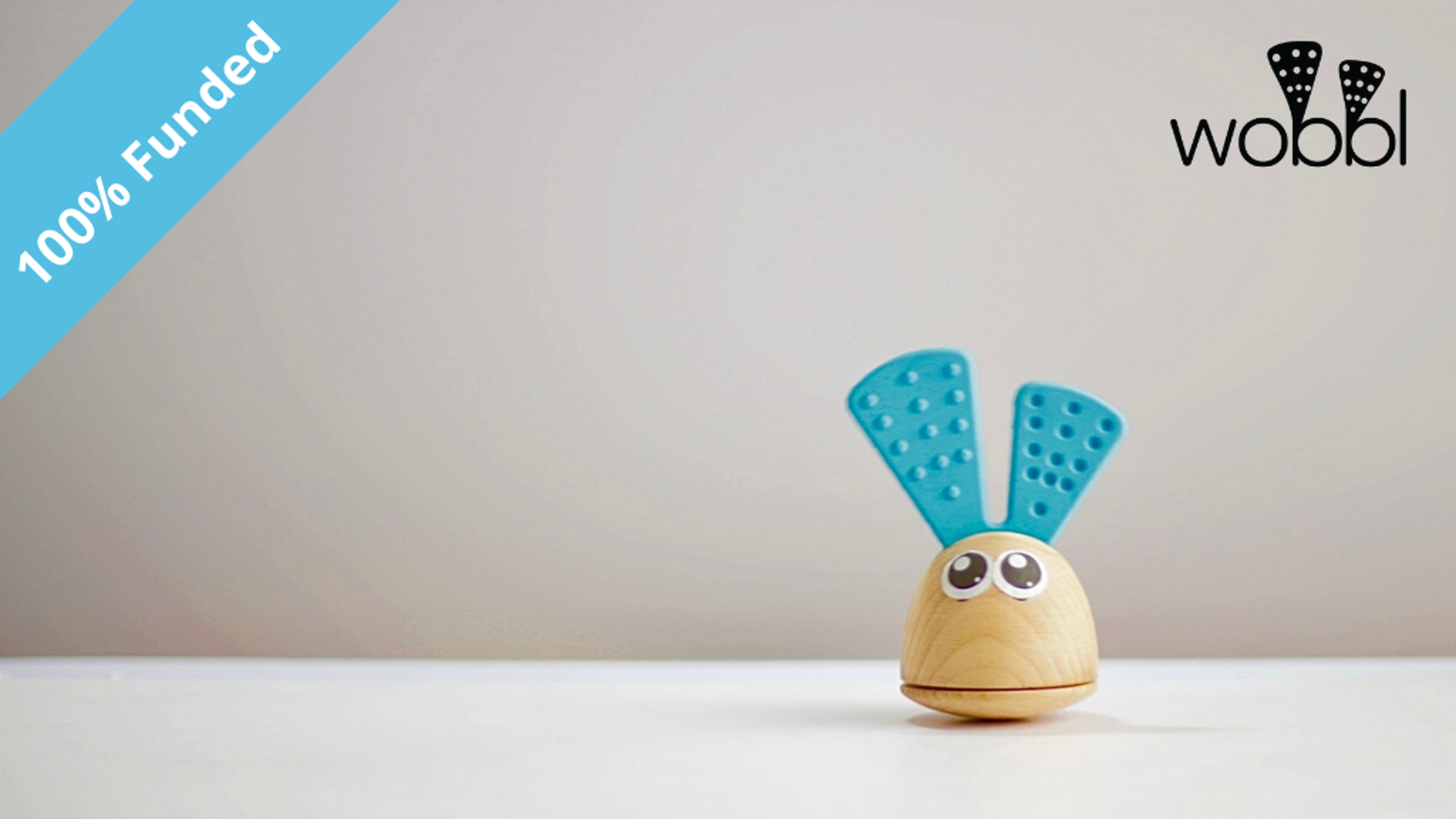 Teether - Rattle - Tummy Time toy.Montessori inspired and backed by developmental science. Handcrafted from beechwood and 100% food grade silicone. Safety tested.