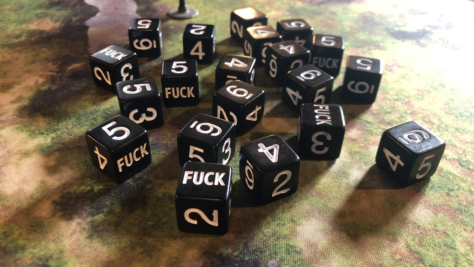 Professionally manufactured six-sided dice with FUCK instead of 1.