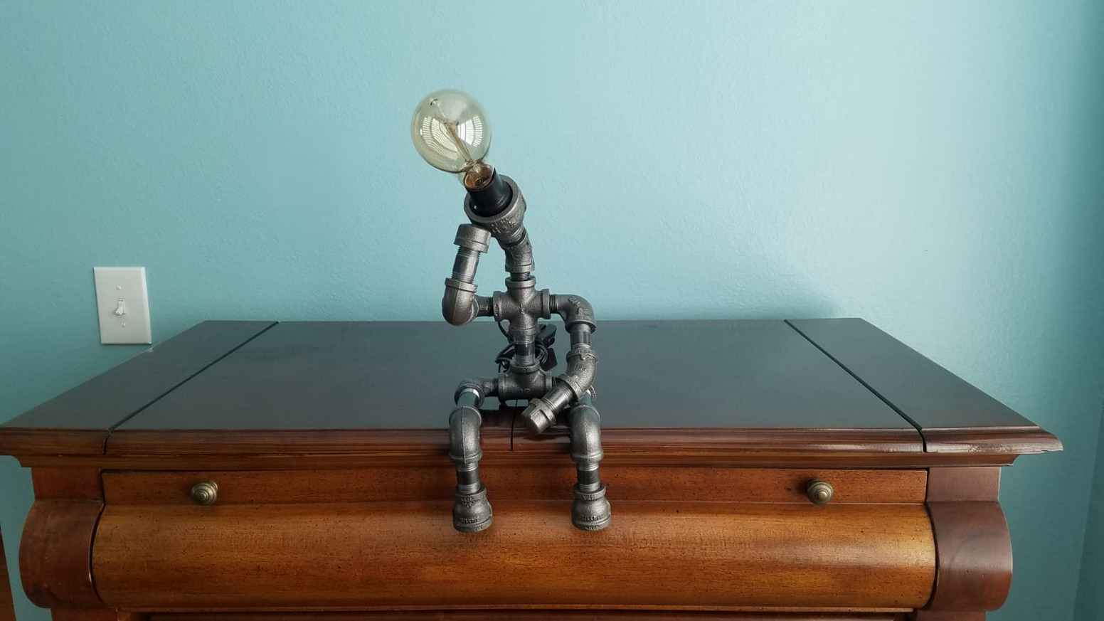 The Thinker recreated as a steampunk lamp.