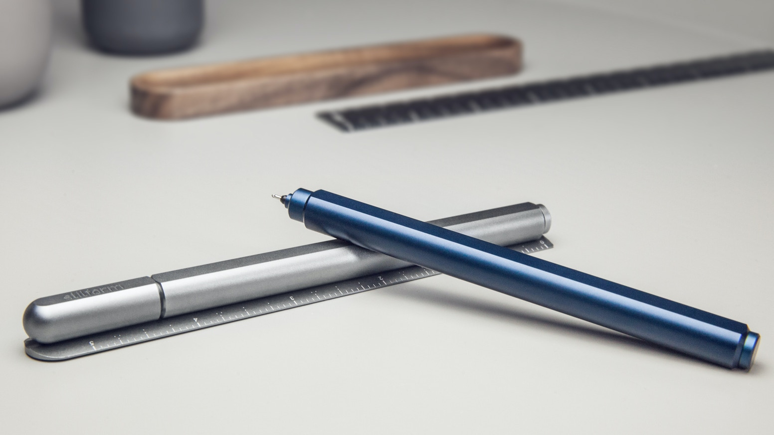 A Minimalist Gel Ink Pen with a Magnetic Self-Aligning Mechanism and an Innovative Ruler Cap. Fun to fidget!