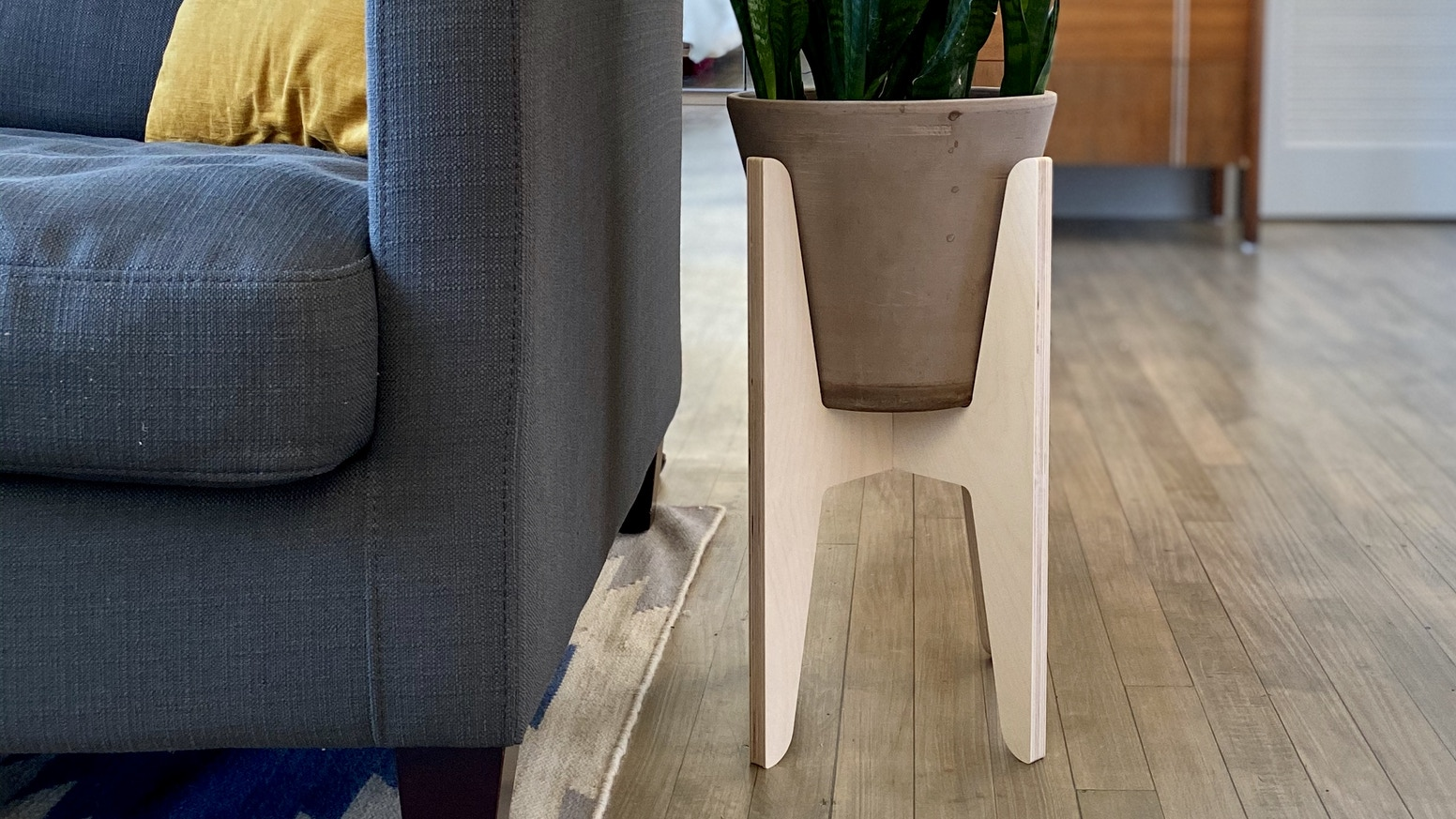 Pamper your plants with Pedestal, an adjustable plant stand and side table.