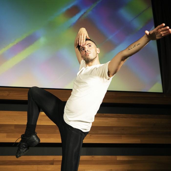 Creator-in-Residence José Rivera, Jr. working on choreography in Kickstarter HQ's theater