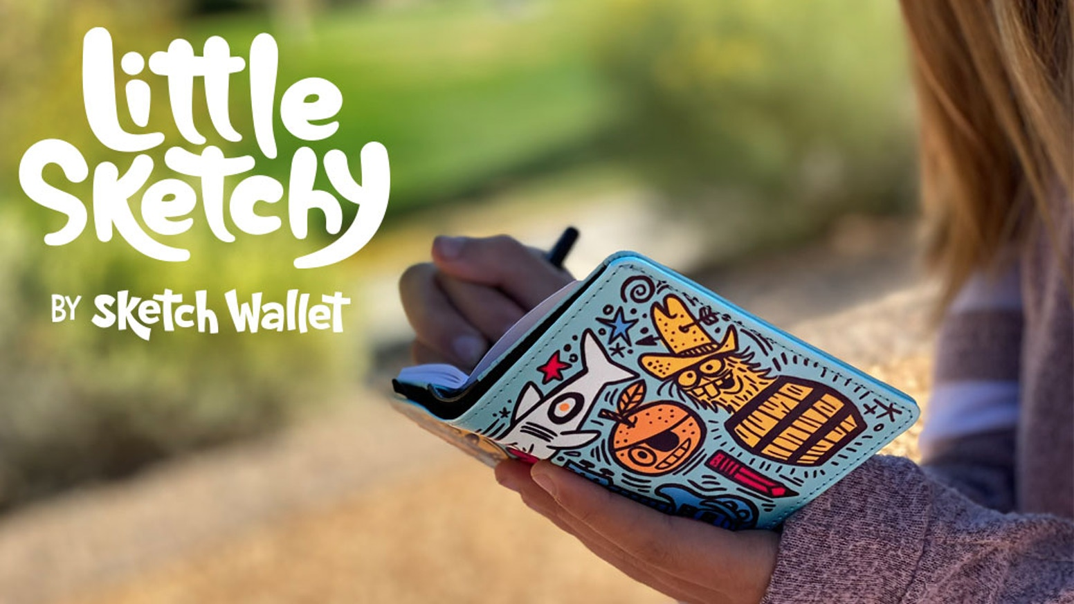 It's a wallet with a sketchbook inside - for kids!