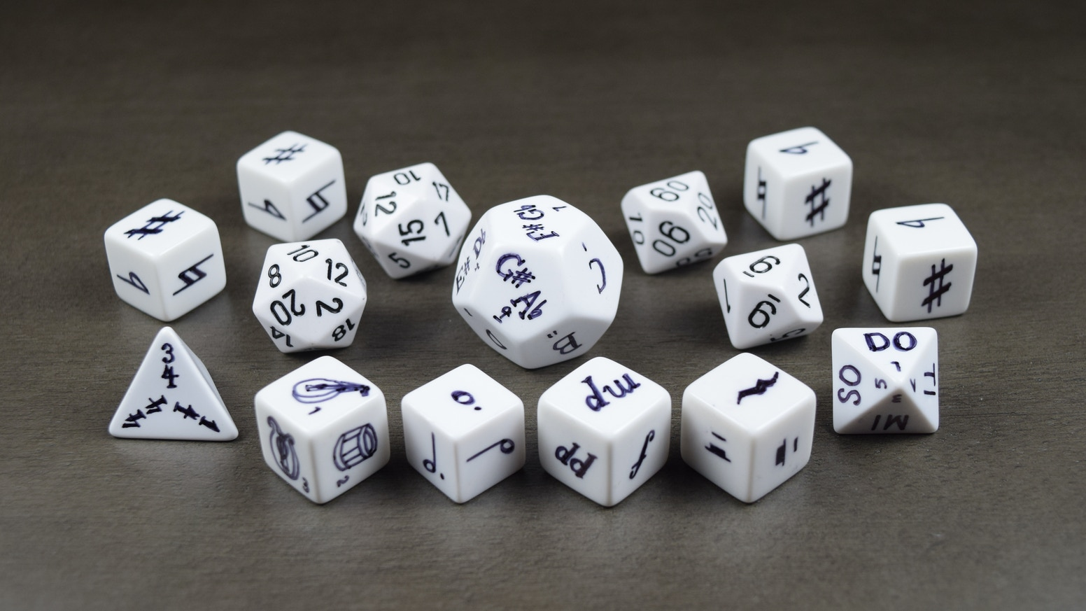 Music-themed polyhedral dice for bards and music-loving players of D&D and FUDGE.