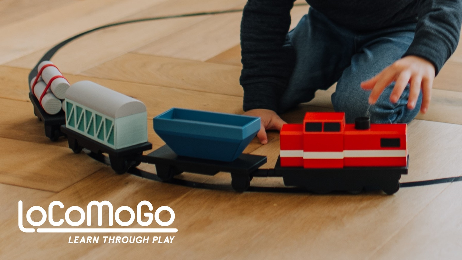 The toy train teaching children aged 4-12 coding through play. Educational journey from screen-less play to full on programming.