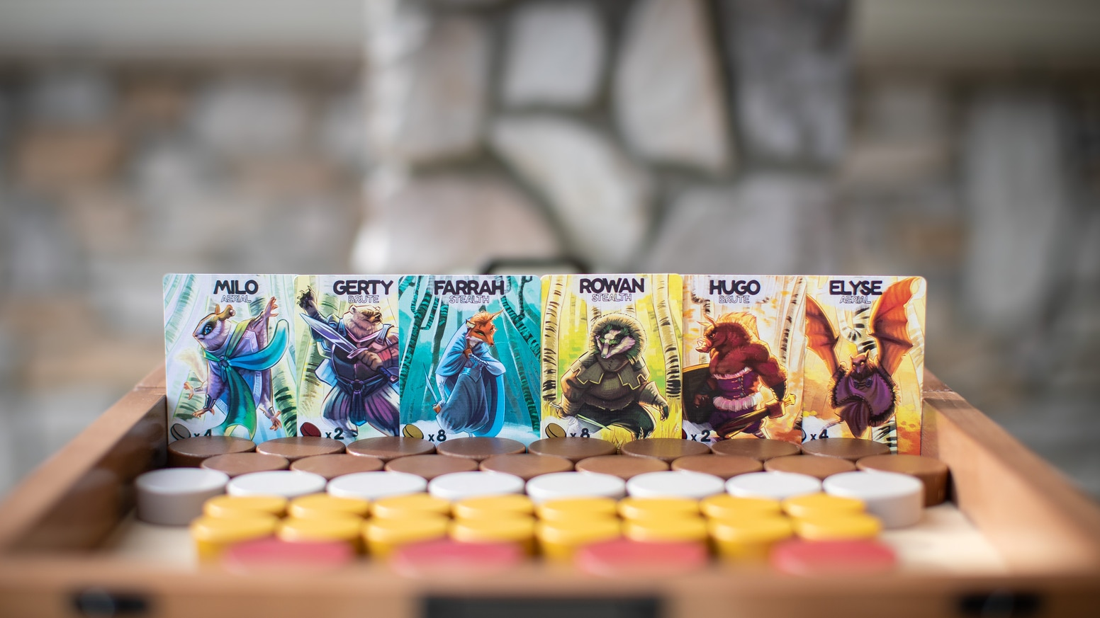 A handcrafted tabletop dexterity game. Lead your faction of woodland creatures into battle and restore order to The Veiled Forest.