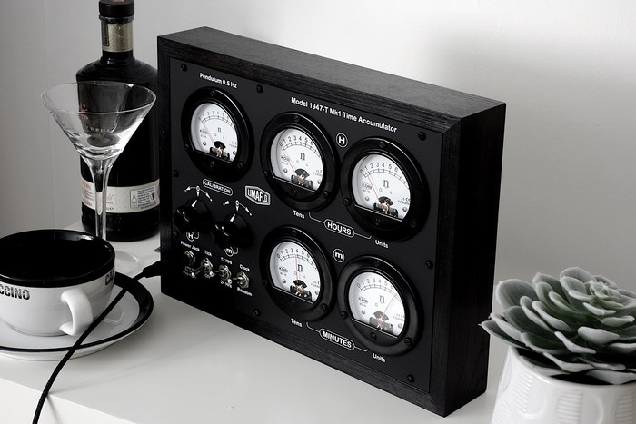 Handcrafted in Sussex, an entrancing arithmetic bakelite-meter clock for the 'unique thinker', housed in a solid ebonised-ash enclosure