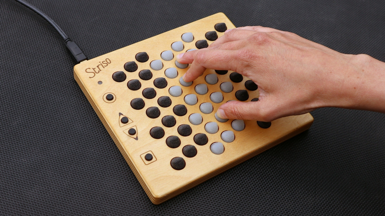 An expressive instrument/MIDI controller with an innovative note layout that helps understand music theory