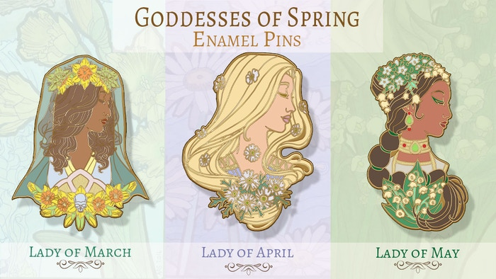 A set of Art Nouveau inspired hard enamel cloisonne pins with a theme of flowers and birthstones for March, April, and May.