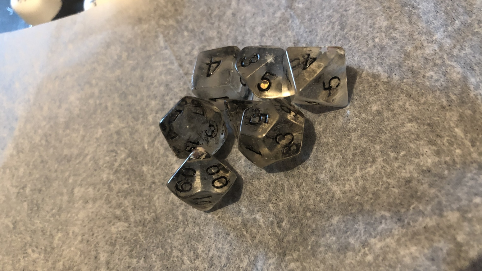 Handmade at home without big companies. Custom and basic dice sets as well as some special dice!