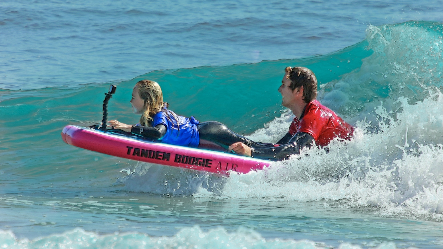 The Tandem Boogie™ Board's unique design allows two people to catch and ride waves together regardless of skill or ability.
