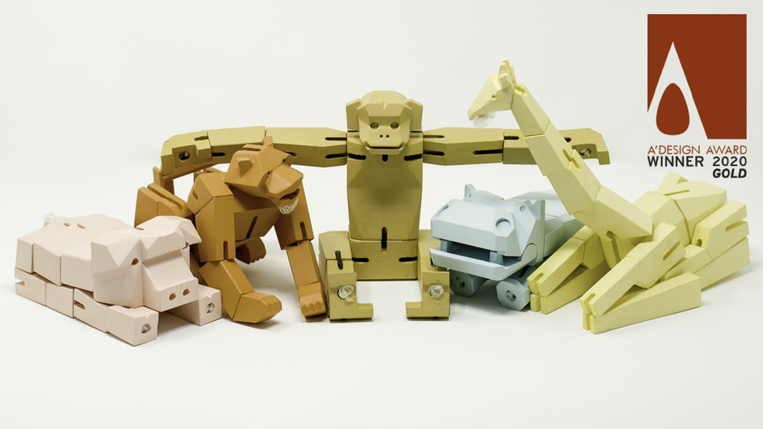 Geometric, transformable, animal figurines that fold into cuboids and fit snugly into their resting boxes.