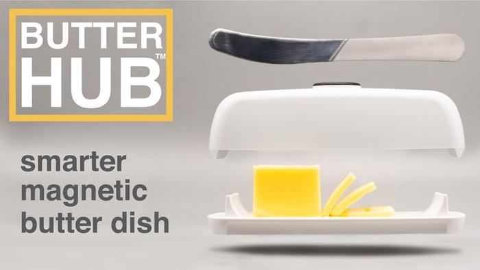 A stylish butter dish with a magnetic lid to hold a knife, extended feet to keep butter mess off the table, and easy scoop ramps.