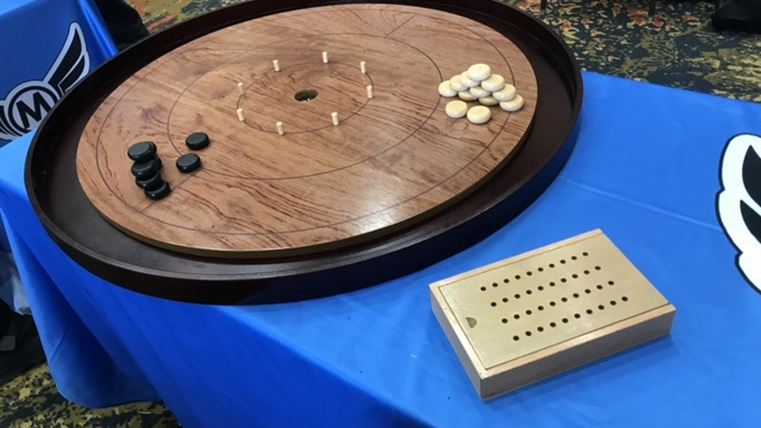 Our 7th Edition Crokinole Board will include many of our past great features plus the added holder for scoring 20s during play.