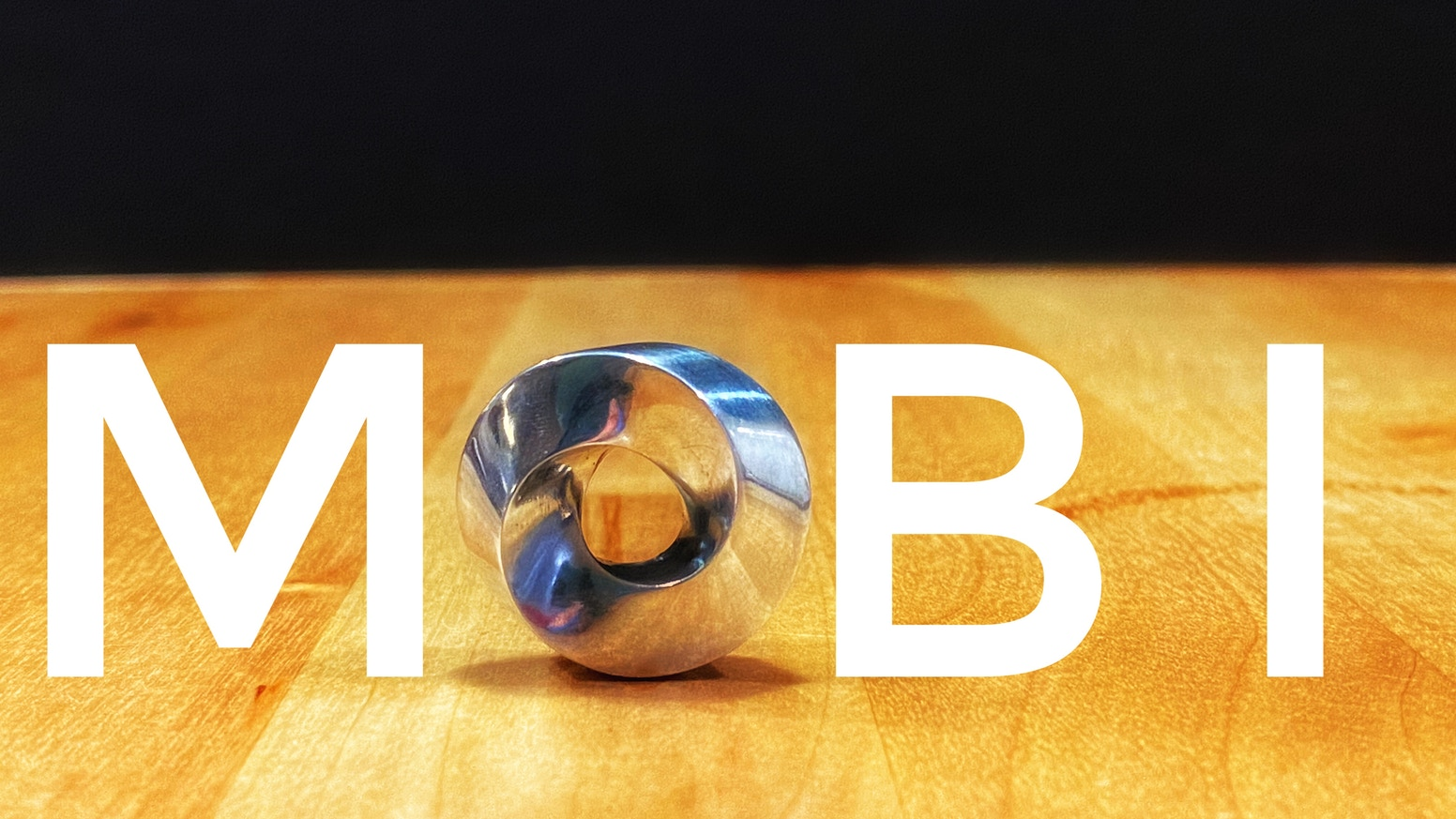 Mobi is an umbilic torus with convex edges. Our Kickstarter's purpose is to be able to make new finishes for our original design.